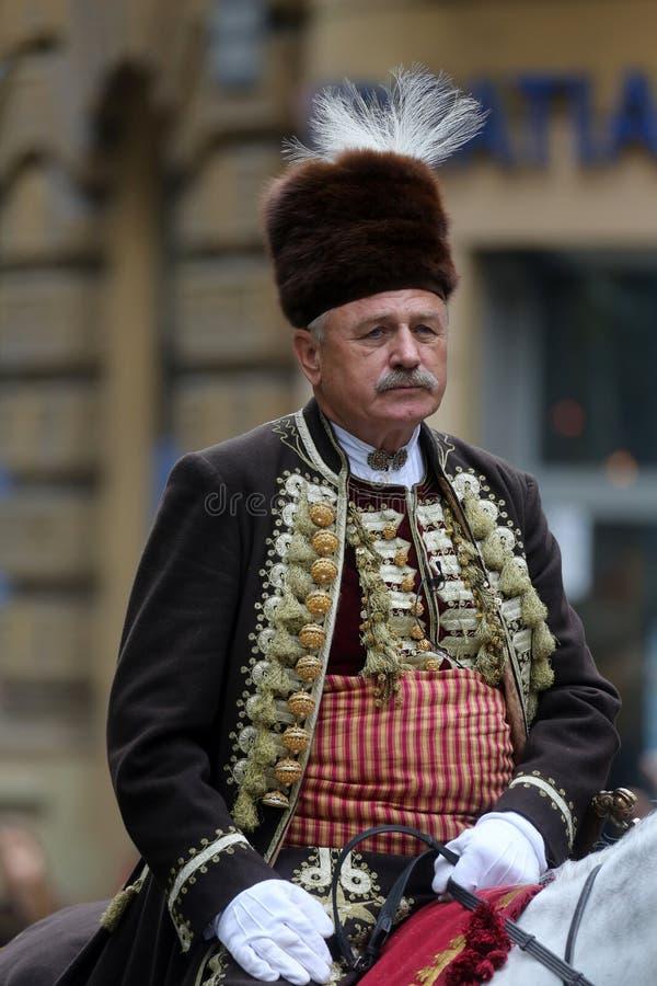 Parada 70 uczestników, dwadzieścia koni i czterdzieści członków orkiestra marsszowa, ogłaszał następni 300 Alka zdjęcia royalty free