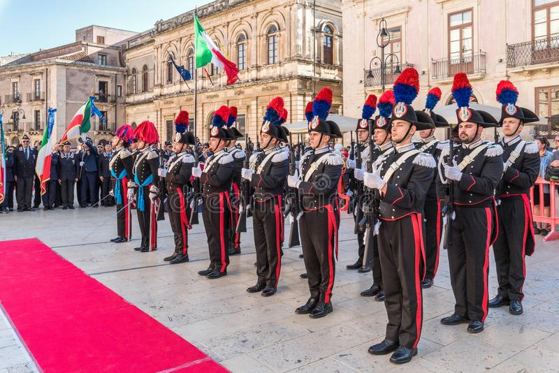 Syracuse Sicily/ Italy -June 05 2019: Parade of the carabinieri who wear the uniform and the historical hats with plume. Parade of the carabinieri who wear the royalty free stock photo
