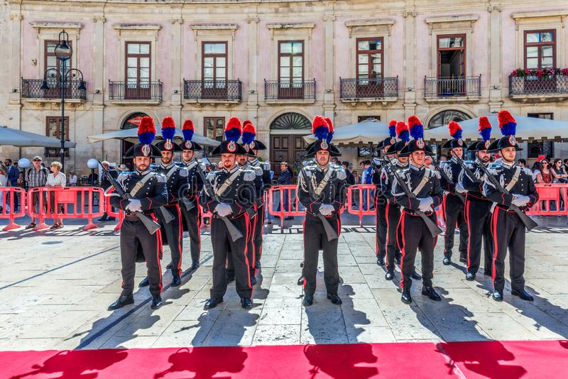 Syracuse Sicily/ Italy -June 05 2019: Parade of the carabinieri who wear the uniform and the historical hats with plume. Parade of the carabinieri who wear the royalty free stock photography
