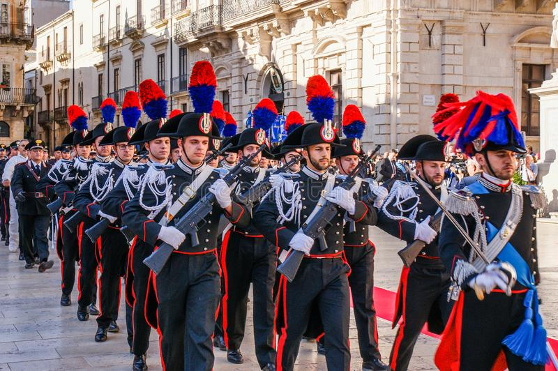 Syracuse Sicily/ Italy -June 05 2019: Parade of the carabinieri who wear the uniform and the historical hats with plume. Parade of the carabinieri who wear the stock photography