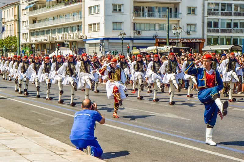 Parade changing of the guard in Athens. Athens, Greece - July 16, 2017: The procession of evzones moves towards the barracks after the ceremonial change of