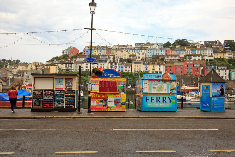 A parade of colourful fishing kiosks in Brixham, South Devon. A parade of brightly coloured Fishing trip kiosks on Brixham hARBOUR IN sOUTH dEVON, eNGLAND, 2017 royalty free stock image