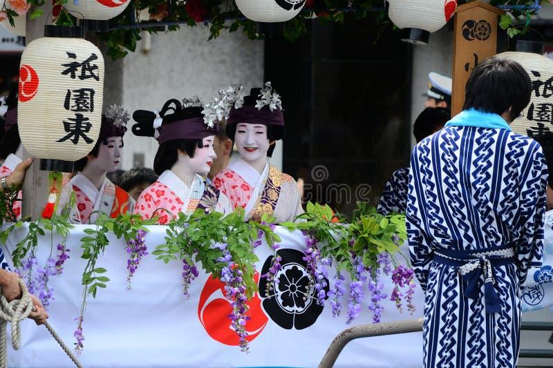 Parade of flowery Geisha girls at Gion festival. Geisha girls riding on the flowery float of Gion Matsuri festival, Kyoto Japan stock photo