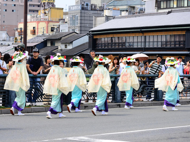 Parade of flowery girls at Gion festival, Kyoto Japan. The second event of Gion festival, blessed women parading with flowery parasols in the center of Kyoto royalty free stock image
