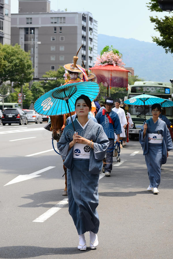Parade of flowery girls at Gion festival, Kyoto Japan. The second event of Gion festival, blessed women parading with flowery parasols in the center of Kyoto royalty free stock photography