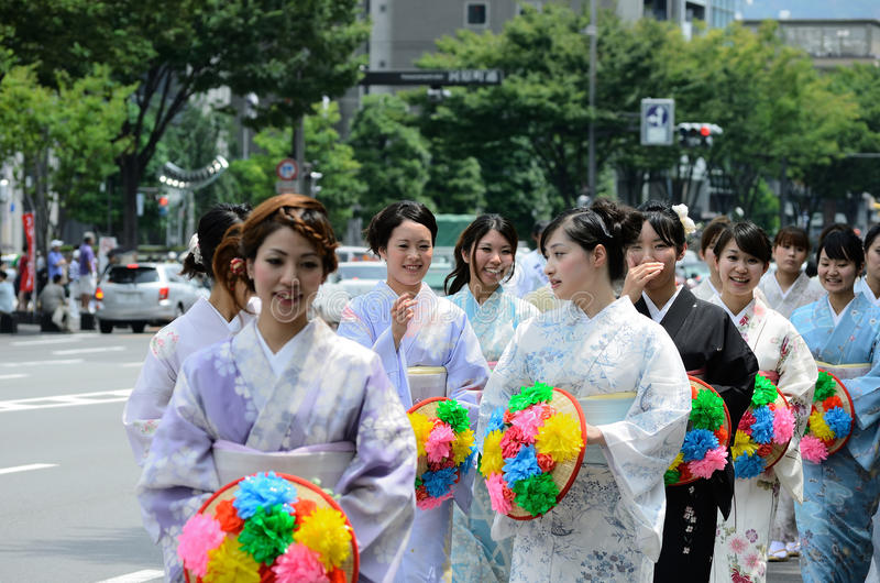 Parade of flowery girls at Gion festival, Kyoto Japan. The second event of Gion festival, blessed women parading with flowery parasols in the center of Kyoto stock images
