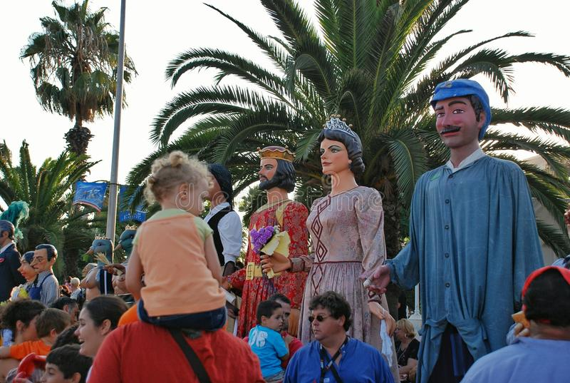 Parade of huge dolls. Holiday La Merce on September 22-25. A holiday in honor of the patroness of Barcelona – the Saint maiden Mercedes. Along with royalty free stock image