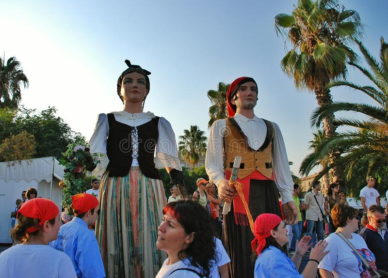 Parade of huge dolls. Holiday La Merce on September 22-25. A holiday in honor of the patroness of Barcelona – the Saint maiden Mercedes. Along with royalty free stock photos