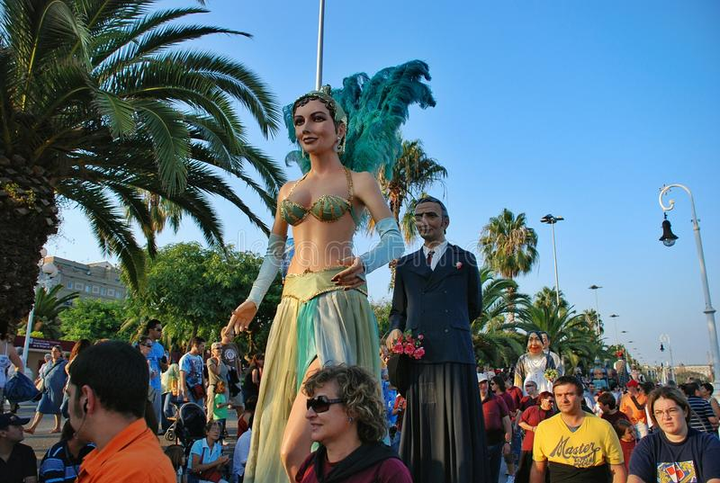 Parade of huge dolls. Holiday La Merce on September 22-25. A holiday in honor of the patroness of Barcelona – the Saint maiden Mercedes. Along with royalty free stock photography