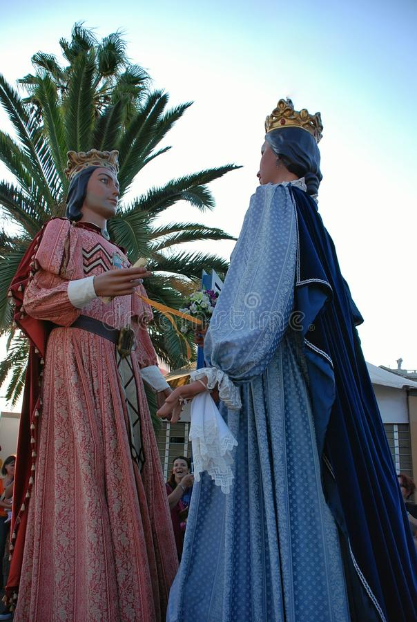 Parade of huge dolls. Holiday La Merce on September 22-25. A holiday in honor of the patroness of Barcelona – the Saint maiden Mercedes. Along with stock images