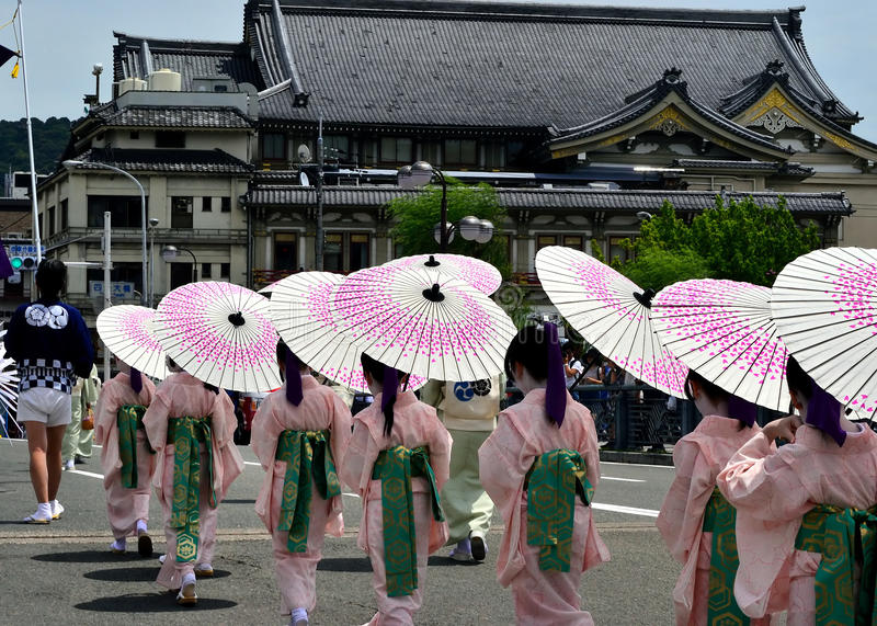 Parade of little Kimono girls, Gion festival scene. Little Maiko girls dedicate their dancing for the holiness of Yasaka Shrine, on the festival day of Gion royalty free stock photos