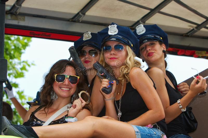 Parade participants dressed as policewomen stock photo