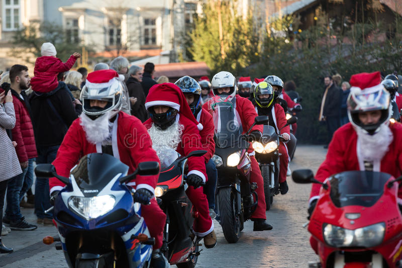 The parade of Santa Clauses on motorcycles around. CRACOW, POLAND - DECEMBER 6, 2015: the parade of Santa Clauses on motorcycles around the Main Market Square in royalty free stock photos