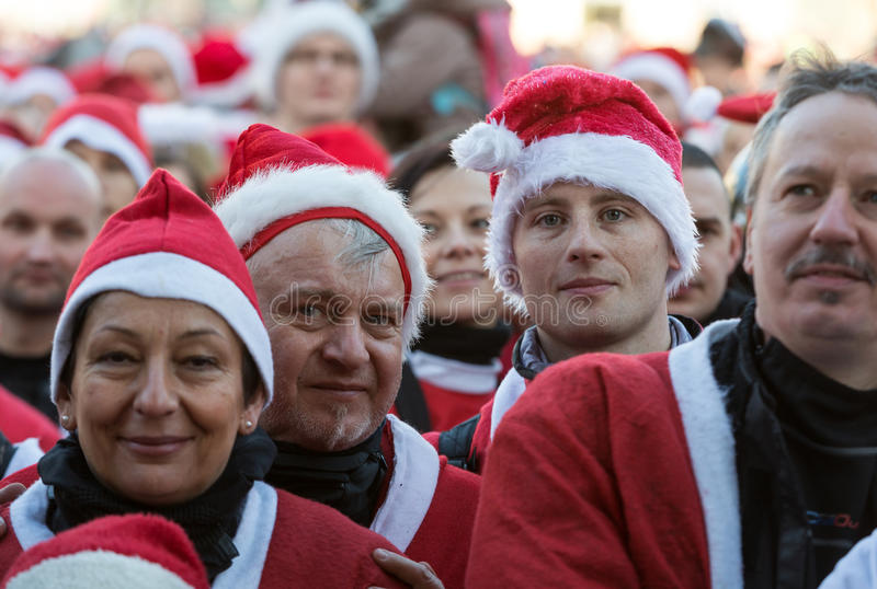 The parade of Santa Clauses on motorcycles around the Main Market Square in Cracow. Poland. CRACOW, POLAND - DECEMBER 6, 2015: the parade of Santa Clauses on royalty free stock images
