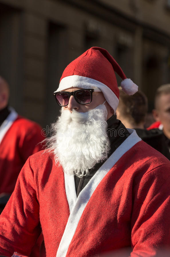 The parade of Santa Clauses on motorcycles around the Main Market Square in Cracow. Poland. CRACOW, POLAND - DECEMBER 6, 2015: the parade of Santa Clauses on royalty free stock photos
