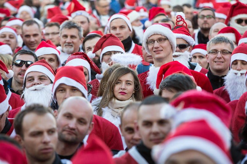 The parade of Santa Clauses on motorcycles around the Main Market Square in Cracow. Poland. CRACOW, POLAND - DECEMBER 6, 2015: the parade of Santa Clauses on stock photo