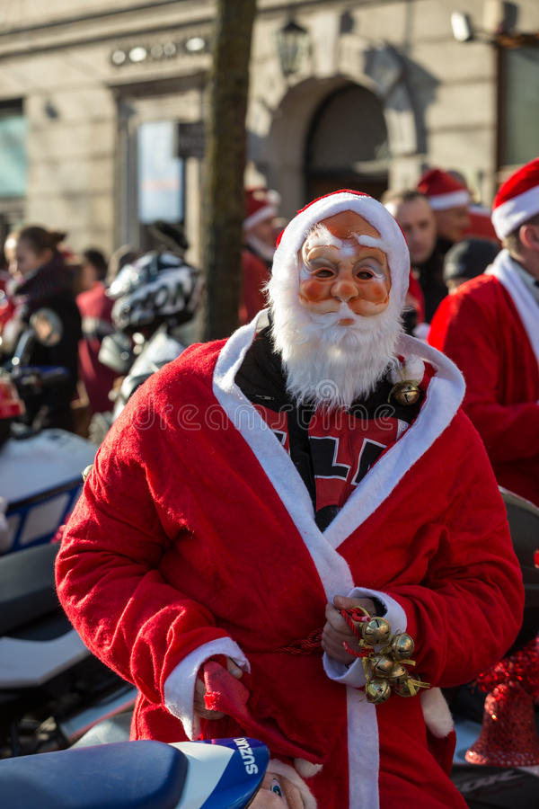 The parade of Santa Clauses on motorcycles around the Main Market Square in Cracow. Poland. CRACOW, POLAND - DECEMBER 6, 2015: the parade of Santa Clauses on royalty free stock photo