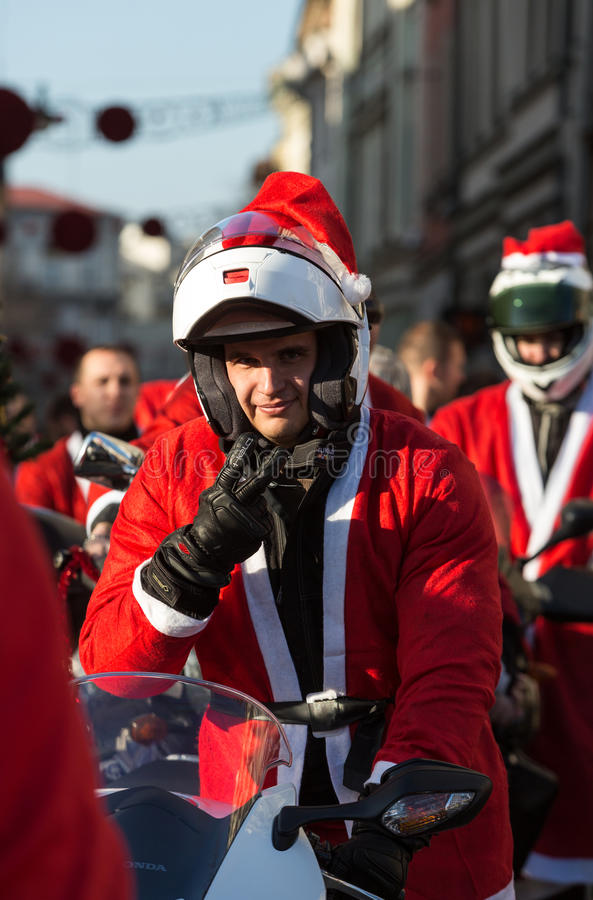 The parade of Santa Clauses on motorcycles around the Main Market Square in Cracow. Poland. CRACOW, POLAND - DECEMBER 6, 2015: the parade of Santa Clauses on stock photos