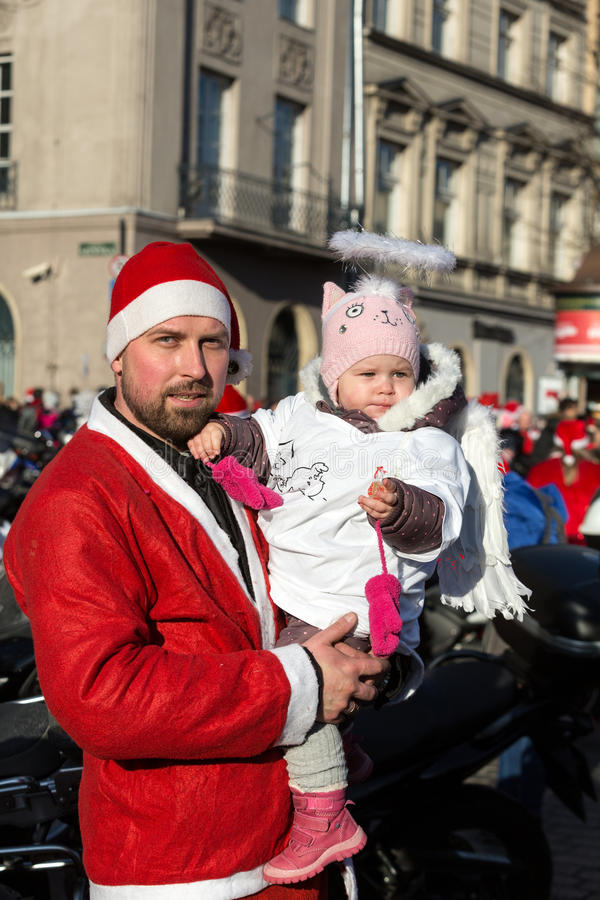 The parade of Santa Clauses on motorcycles around the Main Market Square in Cracow. Poland. CRACOW, POLAND - DECEMBER 6, 2015: the parade of Santa Clauses on royalty free stock photography