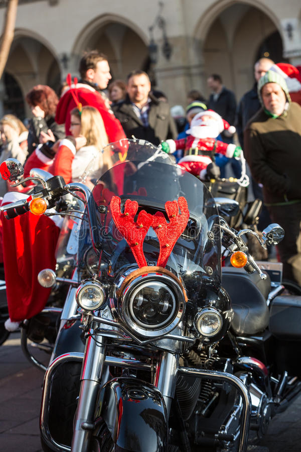 The parade of Santa Clauses on motorcycles around the Main Market Square in Cracow. Poland. CRACOW, POLAND - DECEMBER 6, 2015: the parade of Santa Clauses on royalty free stock image
