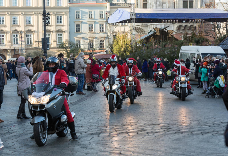 The parade of Santa Clauses on motorcycles around the Main Market Square in Cracow. Poland. CRACOW, POLAND - DECEMBER 6, 2015: the parade of Santa Clauses on stock images