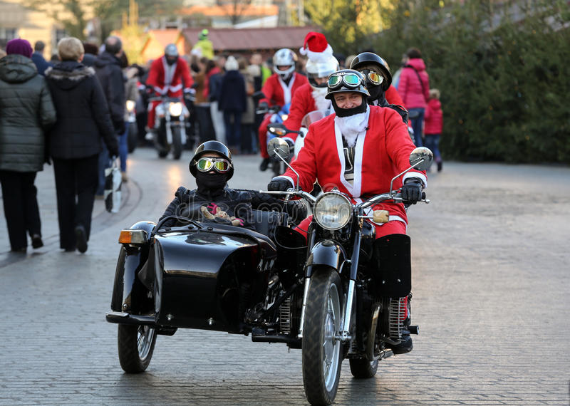 The parade of Santa Clauses on motorcycles around the Main Market Square in Cracow. Poland. CRACOW, POLAND - DECEMBER 6, 2015: the parade of Santa Clauses on stock image