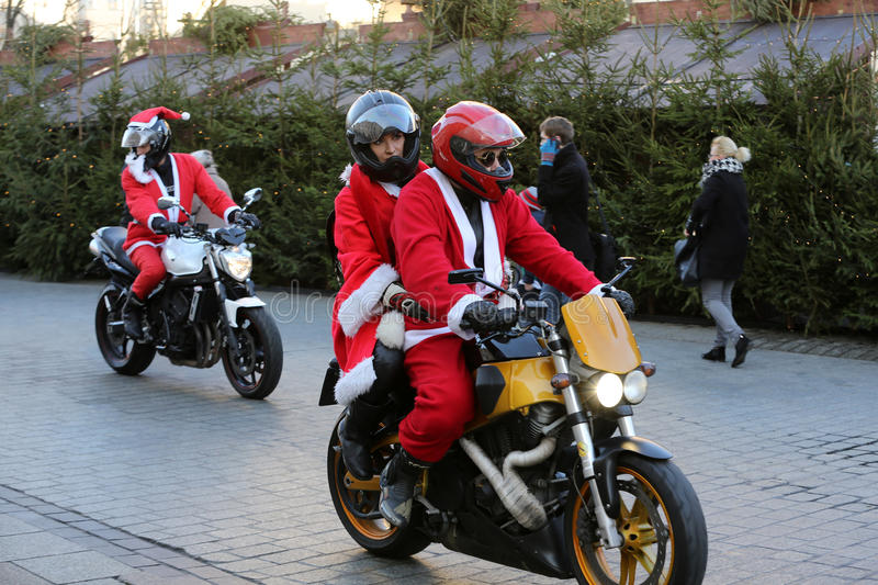 The parade of Santa Clauses on motorcycles around the Main Market Square in Cracow. Poland. CRACOW, POLAND - DECEMBER 6, 2015: the parade of Santa Clauses on stock photography