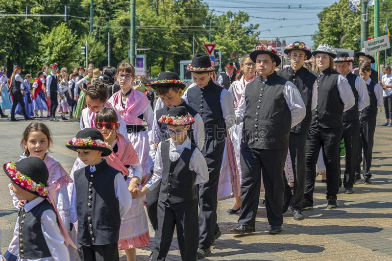 Parade of the Swabian folk costumes, Timioara, Romania. TIMISOARA, ROMANIA - JUNE 16, 2019: The parade of the Swabian folk costumes on the occasion the days of stock photos