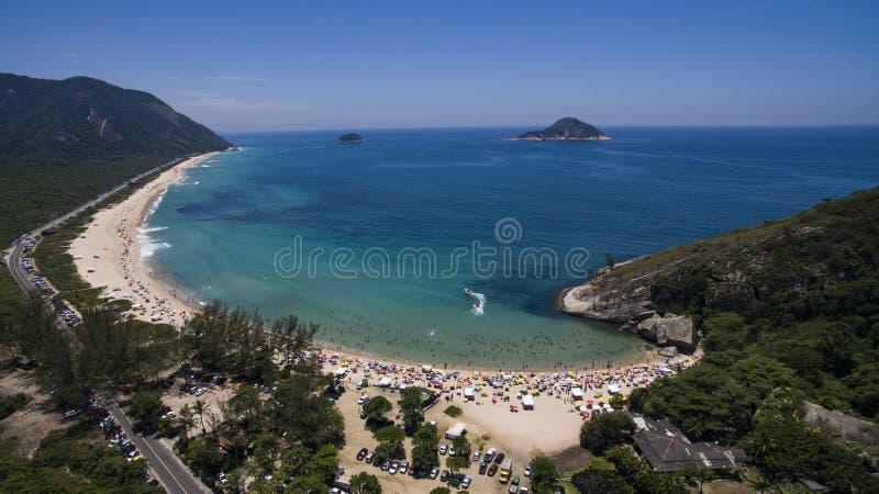 Paradijsstrand, mooi strand, prachtige stranden rond de wereld, Grumari-strand, Rio de Janeiro, Brazilië, Brazilië van Zuid-Ameri stock fotografie