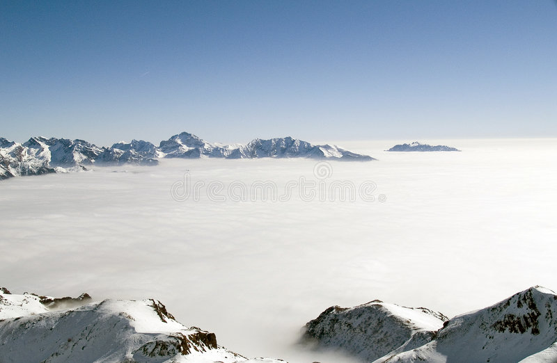 In Paradise. On the top of a mountain above the clouds seem to be in paradise stock photos