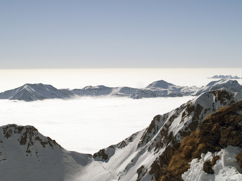 In Paradise. On the top of a mountain above the clouds seem to be in paradise stock images