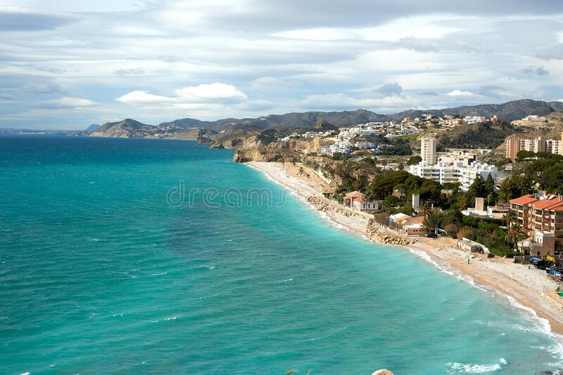 Paradise beach with homes. In Villajoyosa, Spain stock images
