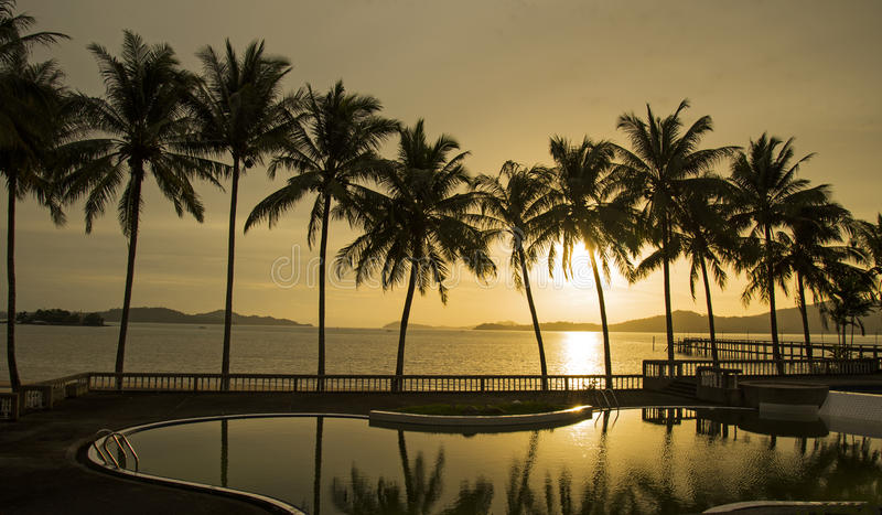 Paradise beach sunset or sunrise with tropical palm trees, Thailand royalty free stock photos