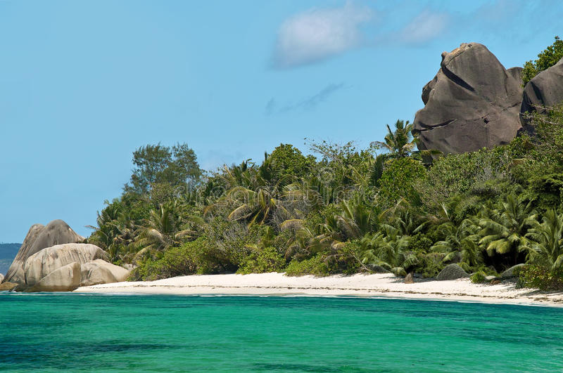 Paradise beach and welcoming rock. stock photo