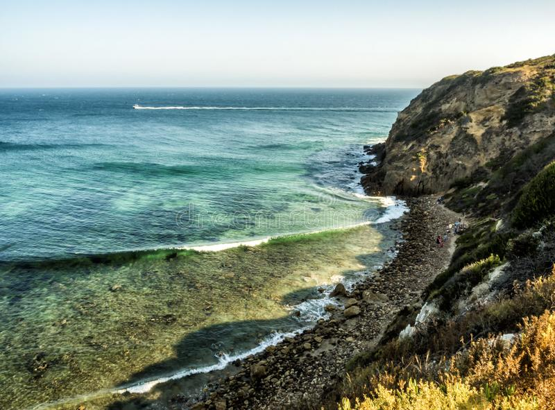 Paradise Cove Malibu, Zuma Beach, emerald and blue water in a quite paradise beach surrounded by cliffs. Malibu, Los Angeles, LA, royalty free stock photography