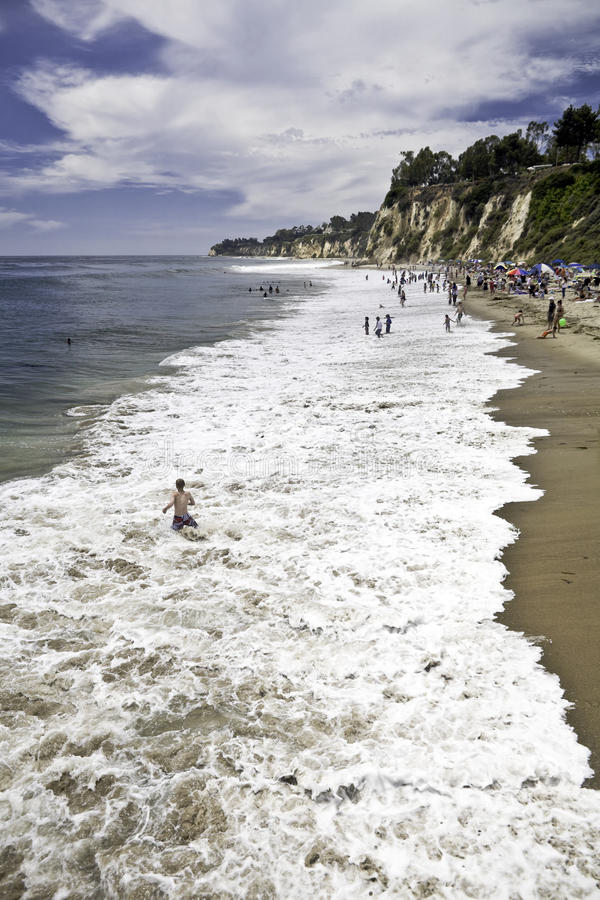 Paradise Cove Surf Bathers. Bathers enjoy the surf at Paradise Cove in Malibu, California royalty free stock photo