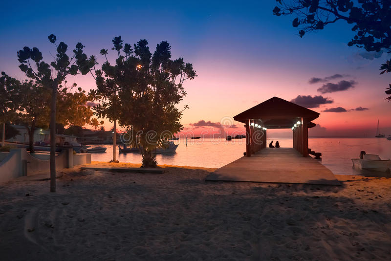 Paradise Maldives beach at pink sunset stock photos