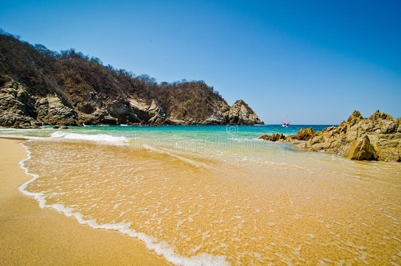 Paradise sand beach with turquoise blue water in Huatulco, Oaxaca, Mexico.  stock images
