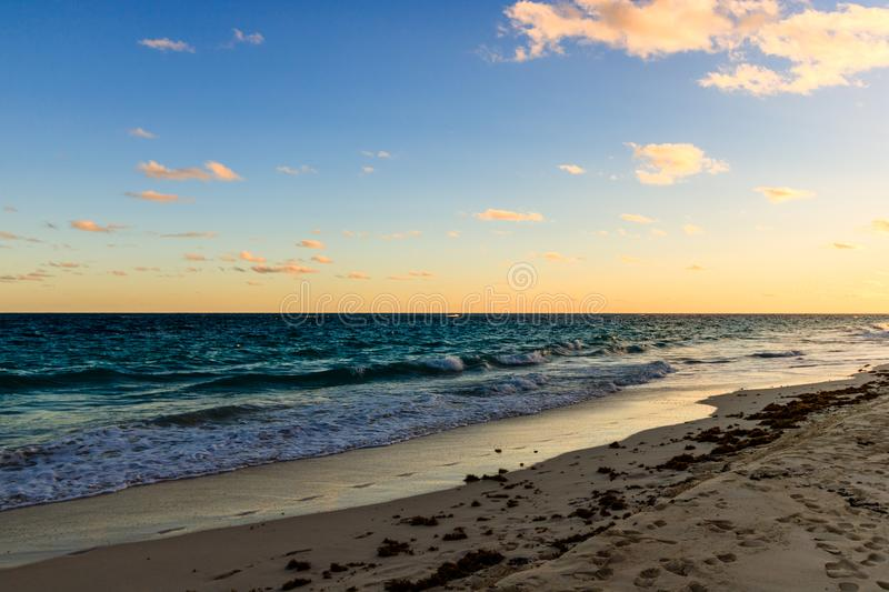 Paradise travel destination beach in Hamilton, Bermuda. Elbow Beach with golden sand and a beautiful sunset.  stock photography