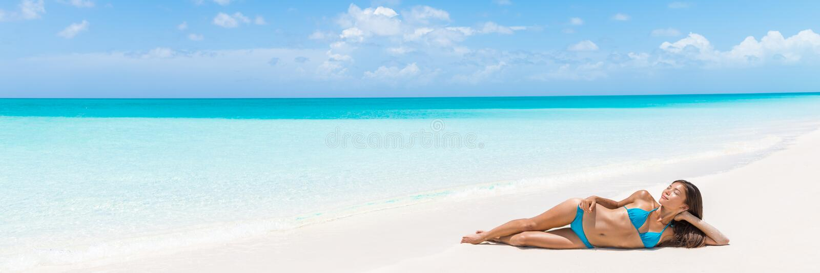 Paradise tropical beach vacation woman relaxing royalty free stock photo