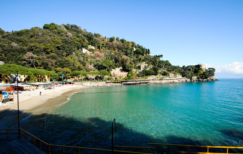 Paraggi near portofino in genoa on a blue sky and sea background. Beach known as paraggi near portofino in genoa on a blue sky and sea background stock photography