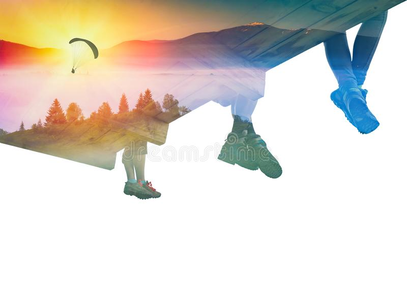 Paraglide silhouette in a sky and group of hikers. Double exposure photography with paraglide silhouette in a sky and group of hikers in a mountain valley. Mixed stock photos