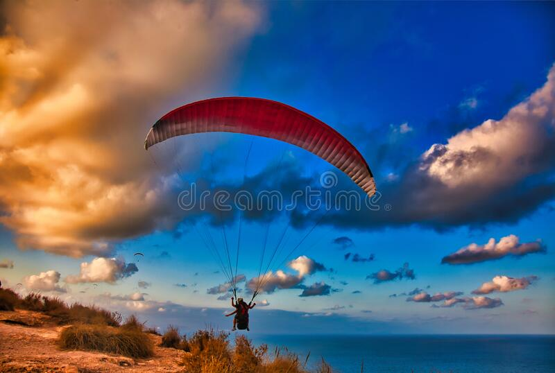 Paraglide at sunset stock photography