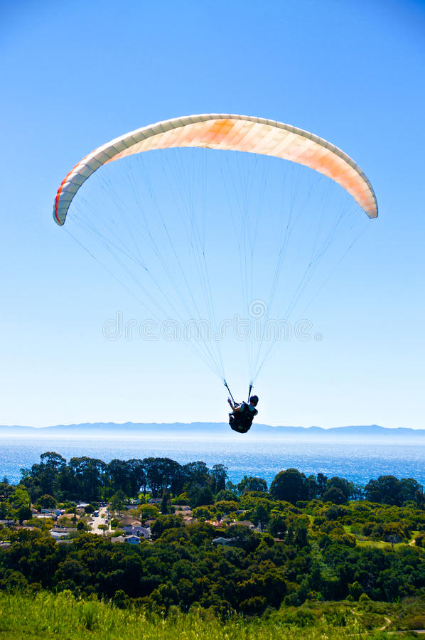 Paraglider above Santa Barbara. Paraglider flies over the coast of Santa Barbara, California with the Pacific Ocean and the Channel Islands in the background royalty free stock photography