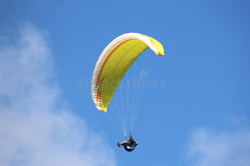 Paraglider in a blue sky stock photography