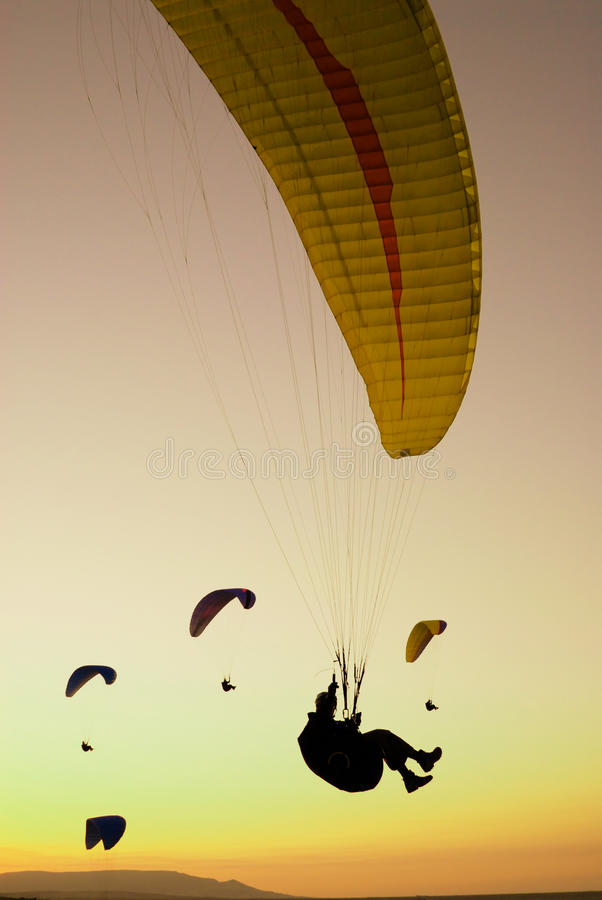 Paraglider in the dusk sky stock image