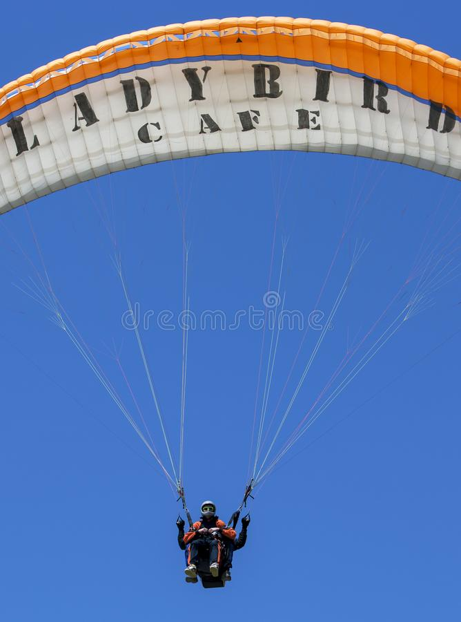 A paraglider flies above Oludeniz Beach on the Turquoise Coast of Turkey. royalty free stock images