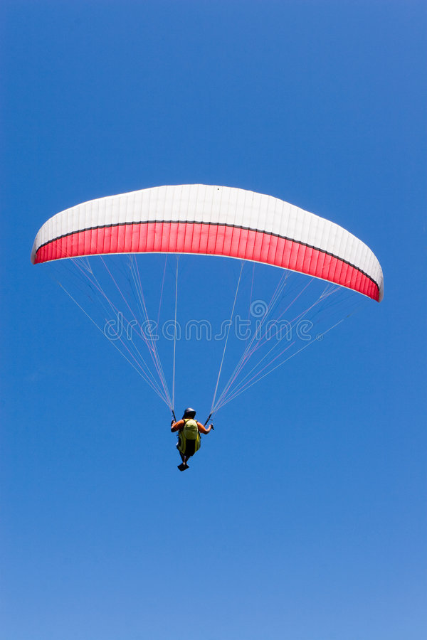 Paraglider Flies Into the Blue stock photos