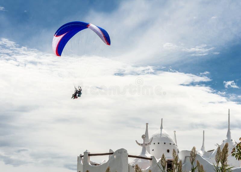 Paraglider flies over the Casapueblo Hous, Punta del Este stock image