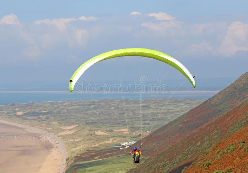 Paraglider flying above Rhossili stock photos
